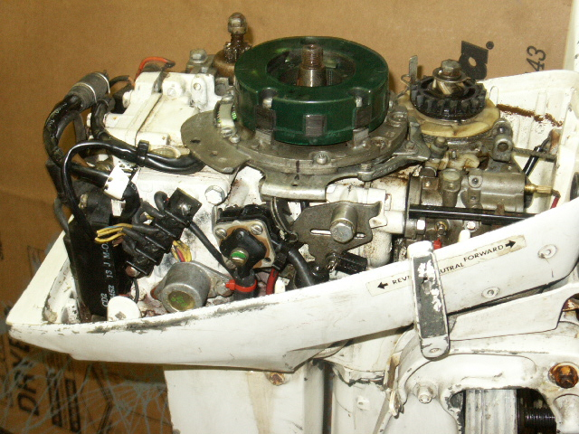 maintaining johnson evinrude 9 this type iii 1987 is a cd rope start model again the visible powerpack at starboard rear also the shift handle is black plastic
