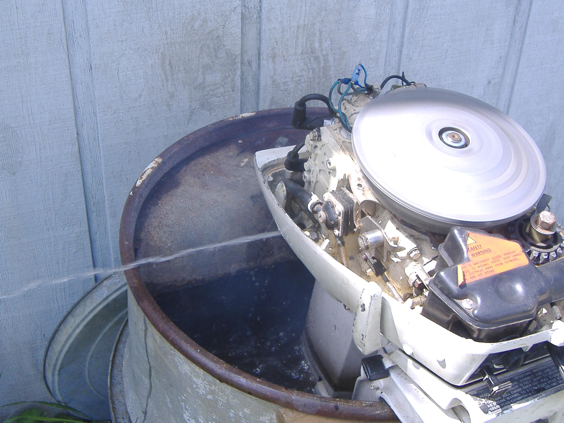 ... Here is the motor running with the new plug screw removed. At a higher  RPM, water squirted over 6 feet.
